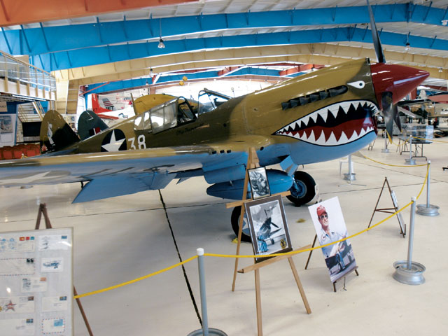 Most people relate the P-51 Mustang to the shark's-mouth-nose art, but it was actually the Curtis P-40 Warhawks that were painted that way. The P-40 was the first plane to splash Japanese fighters in WWII.