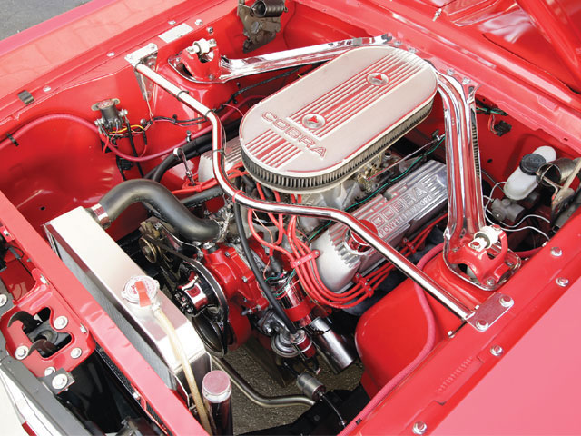 The engine is a '74 302 block with a set of ported '68 cylinder heads. Sayat added the Edelbrock 600-cfm carb to the RPM manifold. You can buy the dress-up kits from Mustangs Plus.