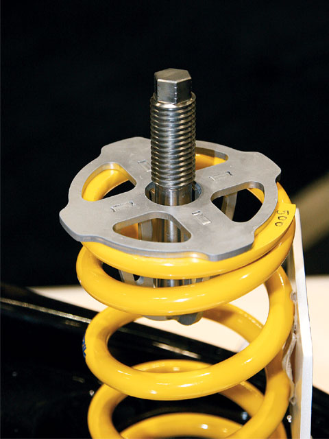 This new coil spring adjuster system from AFCO allows the spring top to conform to the compression of the spring as the car negotiates the turns, providing more consistency.