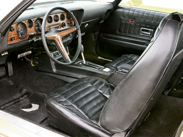 The original, standard, black-vinyl interior with bucket seats and the optional front console were removed to facilitate the restoration, but once complete, they were reinstalled right down to the carpet and headliner. An impressive list of amenities includes custom air conditioning, concealed windshield wipers, and AM/FM/stereo/8-track player. Small items such as the convenience-lamps package, right-side vanity mirror, and Soft-Ray tinted glass all around add luxury touches.