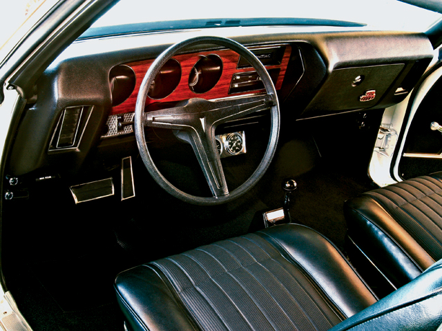 Pristine interior retains its factory appearance, except for a pair of underdash Stewart-Warner gauges and a Hurst Dual-Gate shifter for the Turbo 400 automatic.
