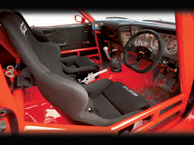 It was decided during the build to remove all the flammable items from the cabin, which in turn necessitated getting the metal surfaces inside as smooth as the ones out. The dash was sectioned and rebuilt around the rollcage, and carbon-fiber and alloy panels replaced much of the trim. During the build, both the seating and steering position were tweaked for optimum ergonomics.