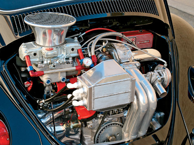 The induction system for Tostenson's 2,276cc (138ci) engine relies on a Turbonetics V069 turbo, Demon 750-cfm carburetor, and a one-off intercooler connected to a water tank filled with ice water.