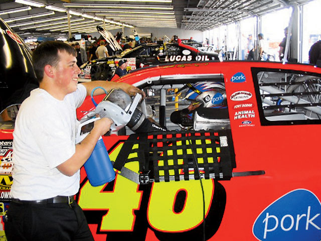 Defending ARCA Champion Frank Kimmel uses a CoreControl during practice at Daytona as the crew works on the car.