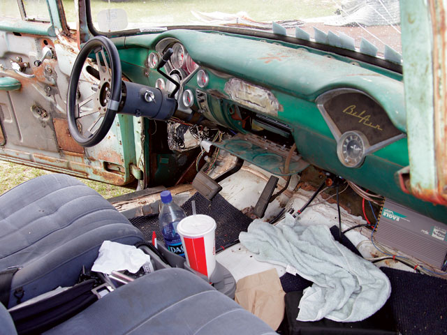Who's up for a road trip? Notice the stereo in the glovebox and the ampszip-tied to the firewall.