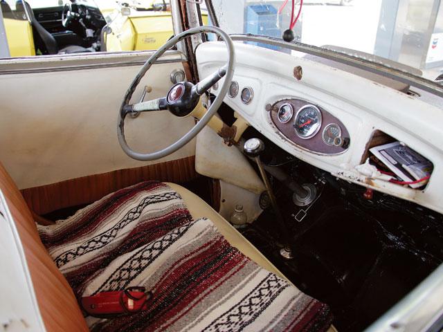 The interior is exactly as Bruce found it, including the '40 Ford columnand wheel and '50s upholstery. He says, the original 1932 upholstery isstill under the '50s threads.