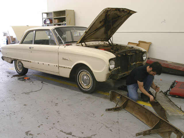 When spraying a car on the quick, it's easy to just mask off trim and go for it. The ultra-thinned paint we'll be rolling on will result in lots of drips and runs initially, though, so it's best to remove all the trim to avoid heavy buildup in the cracks and crevices.