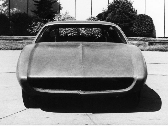 By early September, the basic front end had been approved. This clay shows the large grille opening and sloping fenders, with a slightly recessed hood line that includes a pronounced wind split.