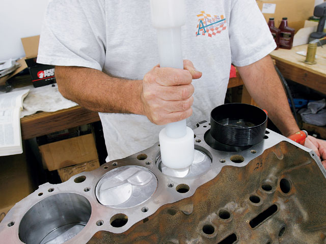 After JGM had cut the stock Speed-Pro hypereutectic pistons, we double-checked our valve-to-piston clearance to ensure the valves would not crash the piston party at high rpm. Unfortunately, this also reduced the static compression ratio down to a realistic 9.9:1 We installed the pistons with a 4.310-inch Powerhouse tapered ring compressor.