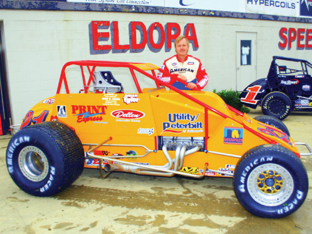 Brian Tyler shows off his Silver Crown dirt car. Note the many differences between it and this pavement Silver Crown car shown below. Photo by Larry Kellogg