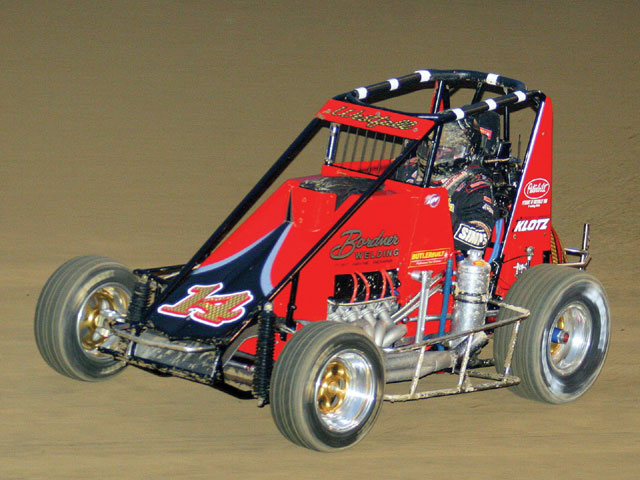 Matt Westfall wheels his Midget through a turn at Eldora. Photo by Larry Kellogg