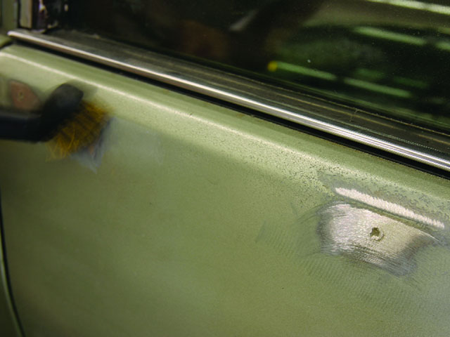 Did you know that GM was still painting its cars with lacquer into the late '80s? This '86 Caprice was sporting its OE Seafoam Green lacquer. Look at how badly the paint is cracked along the top of the doorsill. The whole car needed to be stripped to bare metal.