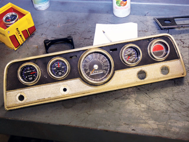 Behold the ugliness and the hacked-in test-fit gauges of the CC/Rambler. We wanted to keep the stock bezels and avoid the stripped look that comes from simply drilling the panel with a big hole saw or using sheetmetal.