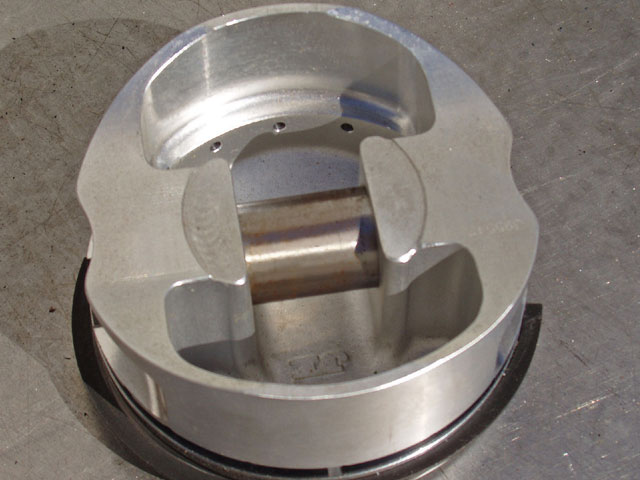 A bottom view of a stout Ross Racing piston that was at Pacific Performance Products shows the thickness of the piston-pin bosses and the ledge inside the dome. This piston is built for extreme abuse.