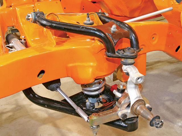 The upper and lower control arms are from Global West, the spindles are stock drum brake '69 F-body and coilover setup is QA1, which is adjustable for both ride height and shock dampening. Note the custom CNC-machined aluminum steering arms BRP made to hook up the steering linkage to the stock '69 spindles.