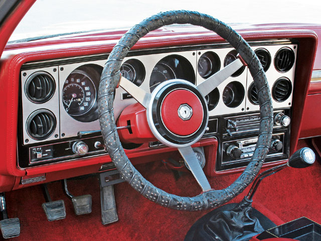 The brushed-aluminum trim plate was a Grand Am-only feature. Electric quartz clock and manifold vacuum gauge are owner added, as is the aftermarket steering wheel cover. Joe replaced the Grand Am's original 85 mph speedometer with a 140 mph unit from an early '70s A- or G-body. Joe says that his friend, Mike Chamberlin, came across it one day while salvage yard hunting, and its odometer reading was within a few miles of that in Joe's Grand Am, so it was installed.