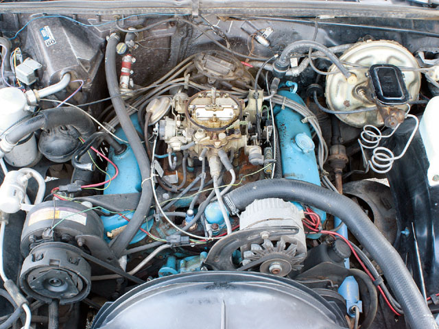 This Grand Am's engine compartment is an untouched timepiece. Though tattered, the PWB-code 301's original scanner label is still affixed to the front of the passenger side valve cover. N41 Power Steering was standard on the Grand Am, but JL2 Power Brakes were required when ordering a V-8 engine or C60 Custom Air Conditioning-this particular car has both. Nearly all of the original coolant and vacuum hoses, and factory wiring remain intact. The only replacement component on the engine is the water pump.