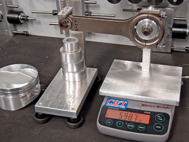 Components such as connecting rods are carefully weighed, along with pistons, rings, and bearings, to get an exact bob weight prior to mounting the crank on the electronic balancer.