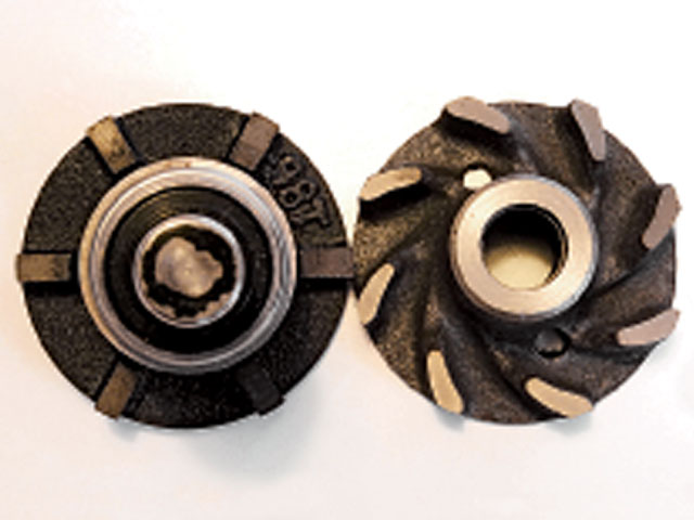 On the left is an early six-straight-blade impeller, a design carryover from 1932 and, in fact, the Model A.