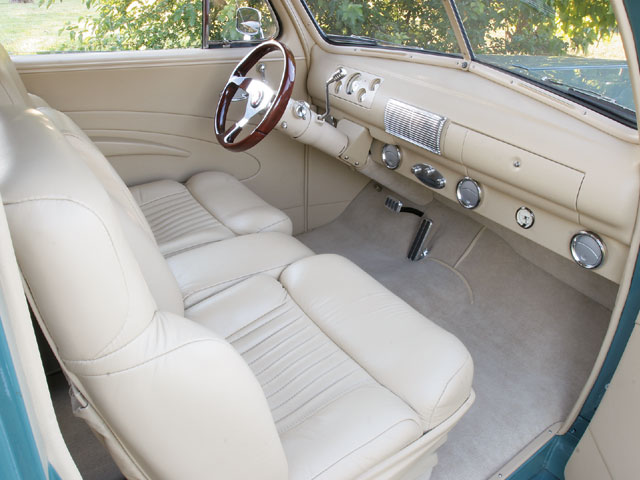 The interior in Paul's ride is clean and simple, highlighted by cream leather installed by Appleman Interiors.