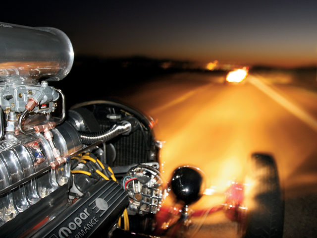 Chris Ward's Mopar-powered T (now that's something you don't hear too often!) offers a unique perspective during the twilight cruise.