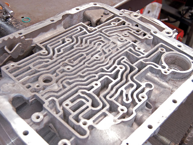 Looking a little like an ant farm, all those passageways in the case are to direct hydraulic fluid to specific locations to apply a clutch or band, or to lubricate a component.