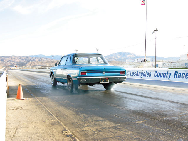 Before we added the Competition Engineering traction bars, the Rambler would squat and unload the passenger-side tire, causing wheelspin.