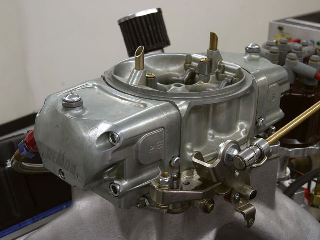Our 383 small-block Chevy test mule consisted of a 383 with a Lunati forged crank, rod, and piston package along with Dart CNC 227 heads, a Holley single-plane intake, and this Barry Grant Mighty Demon 850-cfm carburetor. We used Westech's dyno 1 31/44-inch headers.
