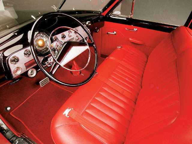 Sergio at Orange Auto Upholstery in Orange, CA, stitched over the stock bench in red vinyl.