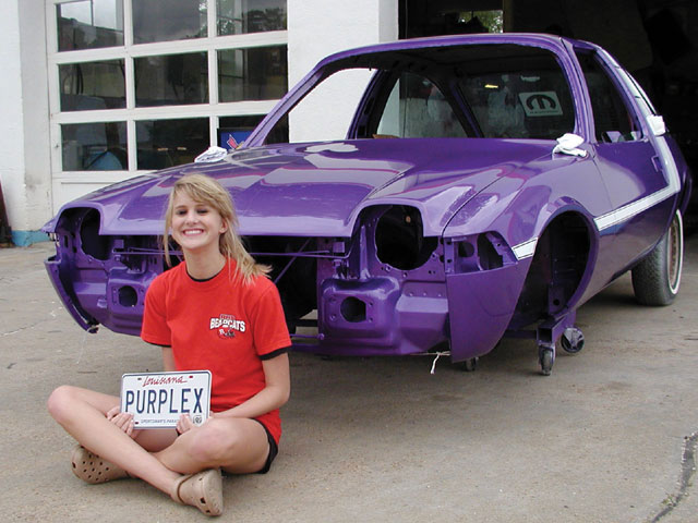 Delaney Auto Design fixed the sheetmetal and laid down the '70 Mopar Plum Crazy paint with a custom stripe Anna Beth designed based on a factory '73 Road Runner graphic.