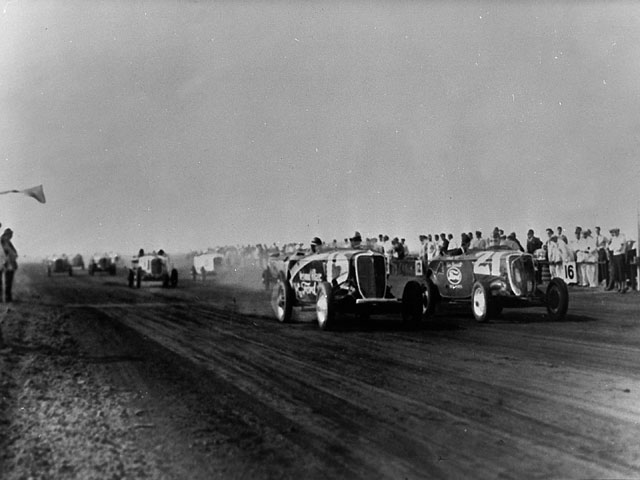Here, on February 24, at the start of the 1934 Gilmore Gold Cup Race, Rex Mays (21) pulls away from Al Gordon (15) who, at the time, thought he was the winner.