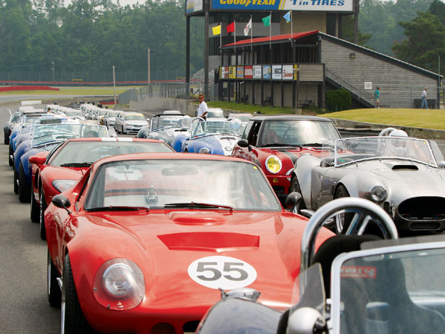 Replicar racers received expert instruction from Mid-Ohio Driving School instructors. David Roush, the man pointing and talking, is the school's general manager.