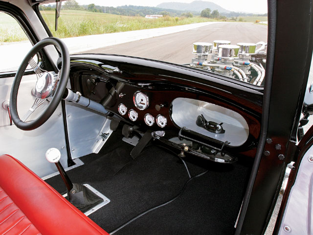 Hot rod interiors were more functional than glamorous in the '50s, so the interior to the Dodge reflects that concept.