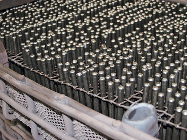 Instead of dumping the parts into a basket for heat treating, ARP stacks these studs vertically in special racks, to ensure consistent heat circulation and penetration on every single part.