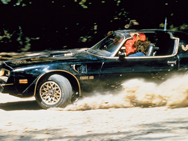 Stunt people kicking up dust in the Bandit T/A. It was scenes like this that gave Smokey and the Bandit a dedicated following that continues to gain fans from every generation. To many people, the Bandit T/A is the baddest car of all time.