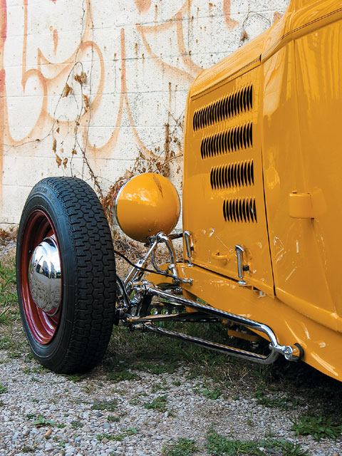 A Rootlieb hood punched full of louvers and polished hairpin radius rods offer continuity to the Deuce's old-school styling.