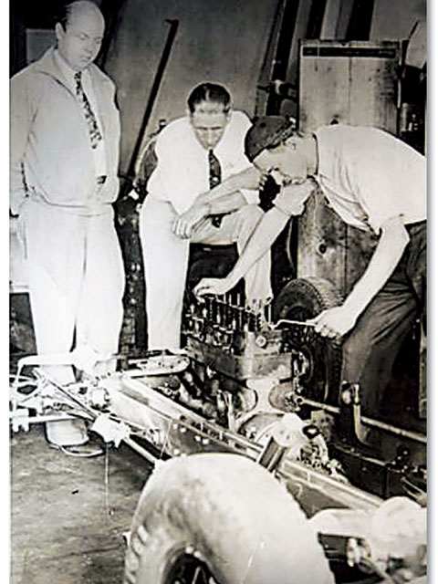 In this photo, taken in 1933, Ed Winfield (left) supervises as one of his rocker arm heads is installed on Paul Fromme's race car. Rex Mays won the West Coast Championship with this car the following year.