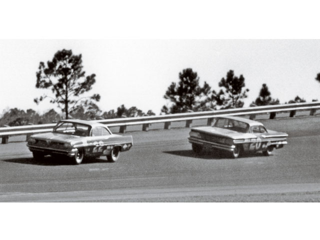 Marvin Panch qualifies in the #20 Pontiac following closely behind Fireball Roberts in #22. Fireball won the pole.