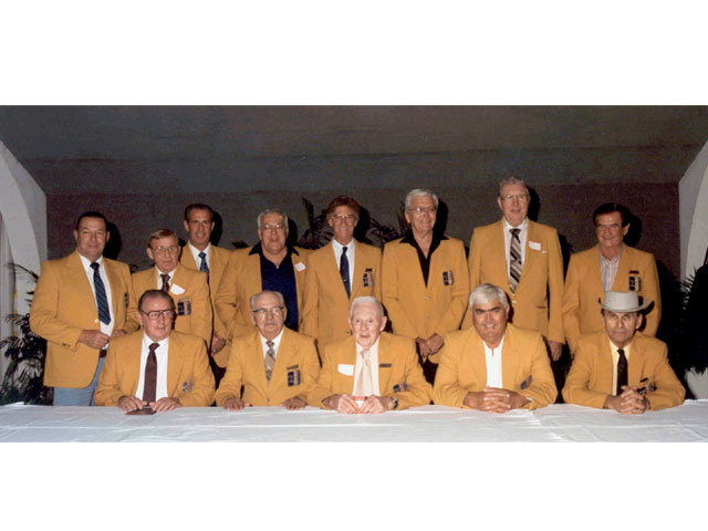 Marvin Panch was inducted into the NMPA (National Motorsports Press Association) Hall of Fame in 1987. Standing from left to right are Jim Paschal, Cotton Owens, Ned Jarrett, Jack Smith, Ray Fox, Tim Flock, Bill France, Sr., and Buck Baker. Sitting from left to right are Marvin Panch, Joe Littlejohn, Red Vogt, Junior Johnson, and Smokey Yunick.