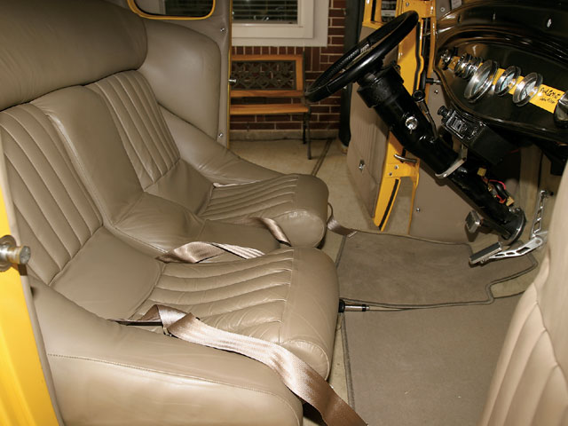 Brothers Jeff and Dave Grabowski created custom seats before trimming them in tan leather. The movie coupe originally had red vinyl tuck 'n' roll upholstery dyed black for the film.