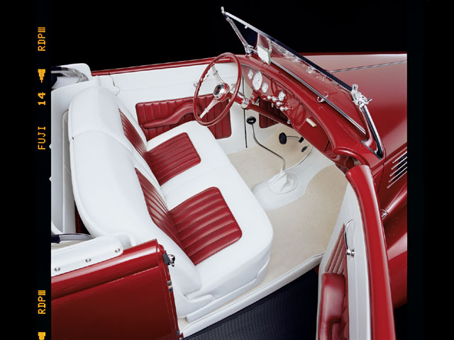 The split-back seat in the car came from a later GM sedan model, possibly a '39 or '40 Chevy. It and the panels astride it wear a herd's worth of hides stitched by Jim Griffin, the go-to guy for builders like Chip and Troy and a few others of whom you may know by their first names.