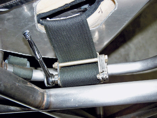 Remove and inspect the seat and seatbelts, especially the portions where they enter the seat openings. Check the date on the belts too. Most tracks and sanctioning bodies have rules governing how old your belts can be. If your seat is out of date, buy a newer one with better supports.