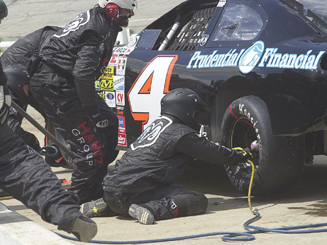 The most visible job in NASCAR is the pit crew, but it does not represent the majority of jobs available. Long before a car gets to the racetrack, it must be built, painted, set up, tested, marketed, shown for sponsors, and driven across the country in some cases. It takes a large, varied assortment of workers to get all of that done. Photo by Kevin Thorne/Penny Holder
