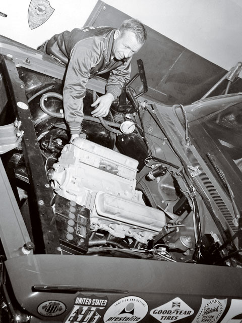Cotton Owens was more than a top-rank NASCAR driver. He was a highly-respected mechanic, too. Here, during the USAC Inspection process, part of the Nichels Engineering 24 Hour Speed and Endurance Runs at Indianapolis Motor Speedway, Owens digs into one of the two '62 Catalinas supplied by Pontiac for the event.