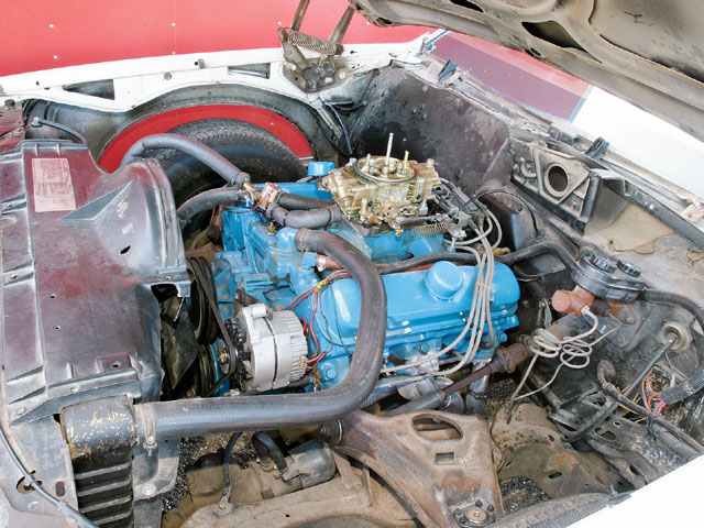 To run in the 10s, Keppler removed the engine accessories, the factory A/C system (notice the handmade A/C delete plate), and the inner fender wells and lightened his front bumper. Notice the two fuel lines. The upper line is for nitrous fuel and the lower line is for gasoline. A Hobbs fuel pressure safety switch is installed in-line to the nitrous fuel system.