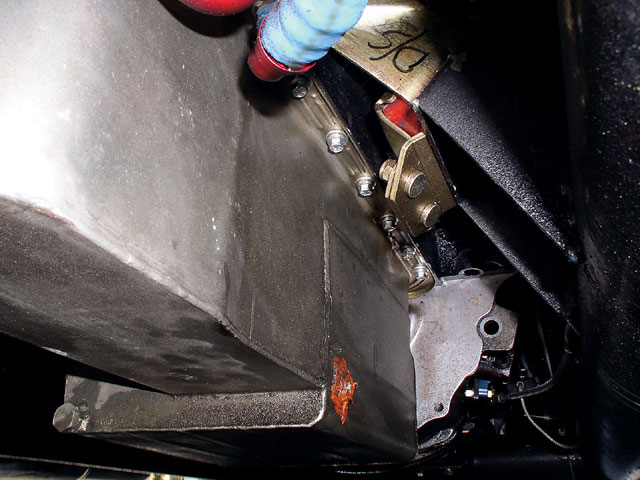 The stock dual-hump oil pan was replaced with a Canton roadracing pan from Breeze Automotive. This pan holds seven quarts of oil and has a baffled pickup area to keep oil covering the pickup.