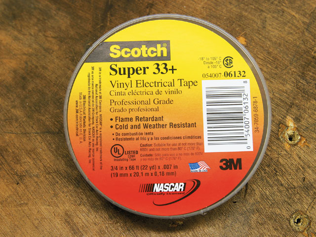 Here's a roll of Scotch Super 33+ black vinyl electrical tape-a premiumgrade, 7-mil-thick, all-weather vinyl-insulating tape. it's designed to perform continuously in ambient temperatures up to 220 degrees Fahrenheit, which means it's great for under hood applications, and it has excellent resistance to abrasion, moisture, alkalis, acids, corrosion, and varying weather conditions.
