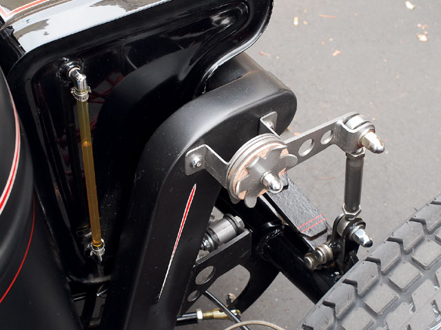 While the unusual engine tends to grab everyone's attention, there are a host of other smaller details worth noting. Check out the sight glass fuel gauge on the custom gas tank, the Speedway friction shocks, holes drilled in the Panhard bracket, and the subtle pinstriping.
