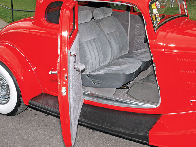 Bucket seats from an '84 Subaru were covered with gray velour with a darker gray velour chosen for the doors. The leCarra steering wheel is mounted on a Chevy van column and VDo instruments provide operating information.