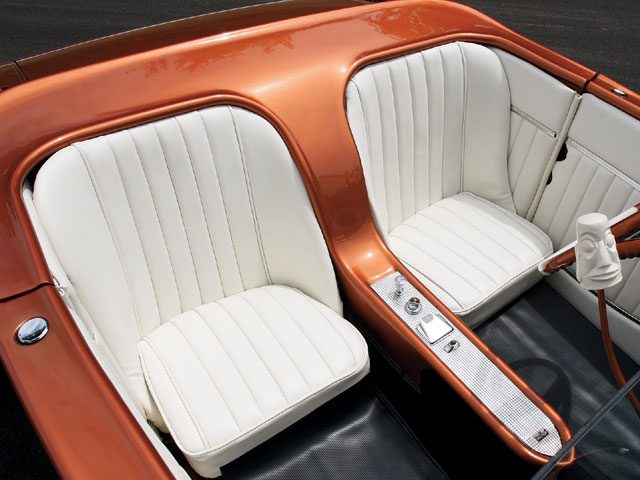 Ed Morley from Ed's BeBop Shop used a white Naugahyde and a roll 'n' pleat design in his creation of the bucket seats for the El Tiki. The center console houses a '55 DeSoto ashtray, a '59 Olds ignition switch, and a '56 Olds headlight switch, all mounted to a piece of extruded aluminum that was found in the back of a '60 Cadillac ambulance.